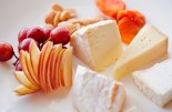 Close up of plate of fruit, cheese and nuts